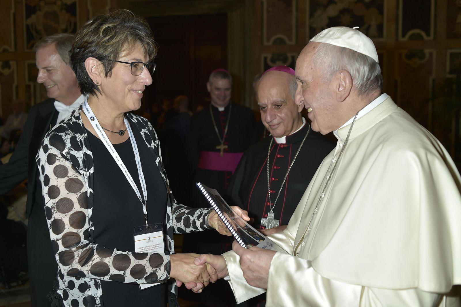 Anne Masters, Director, presenting Book of Greetings to Pope Francis at the Vatcan