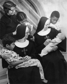 In 1978, members of the Sisters of the Poor of St. Francis—the order that initiated St. Francis Hospital in Jersey City in 1864—get to know some of the young patients at the reorganized St. Francis Community Health Center. Today, St. Francis Hospital functions as a rehabilitation center.