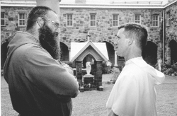 A Franciscan and Dominican brother converse outside the courtyard of the Monastery of St. Dominic, for the Cloistered Nuns of the Order of Preachers, in Newark