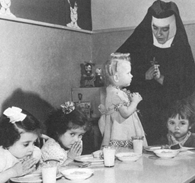 A Religious sister cares for children in an orphanage.